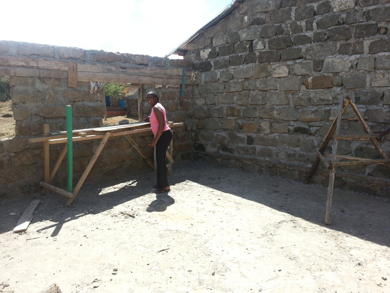 Headmistress/Teacher Mary Naipanoi Tobiko at work on the new classroom