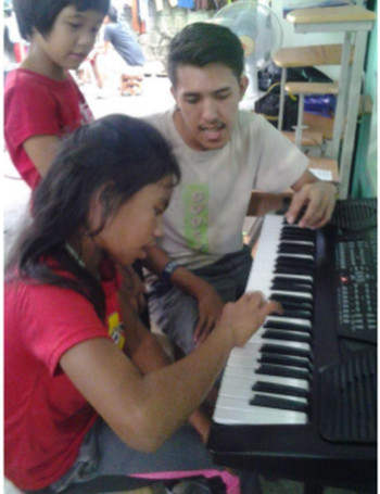Music in a Cart Dianne starting keyboard lessons March 2015