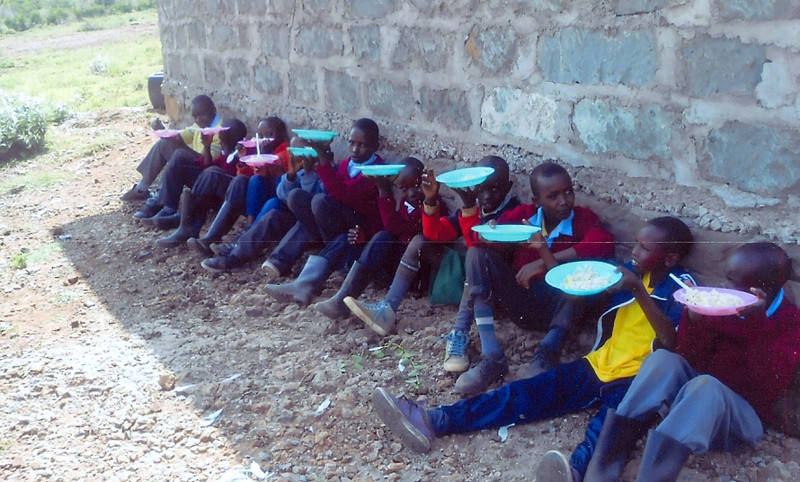 Kitchen boys sitting in shade Namelok Jan 2016