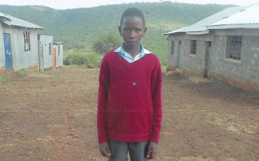 Enock Pariken Jan 2016 outside his school in Kisamis, Kenya