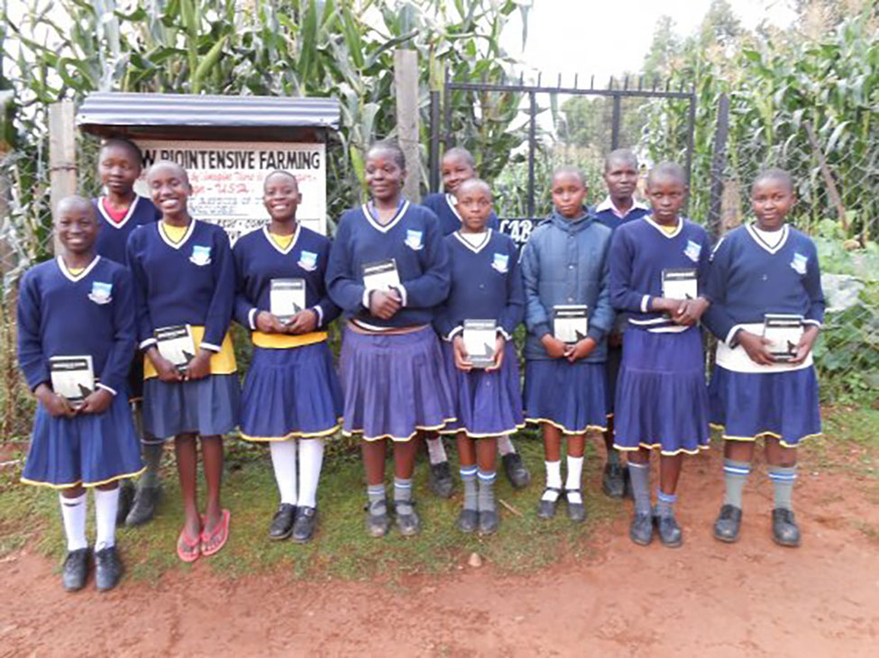 animalian - lenana girls with books by gate