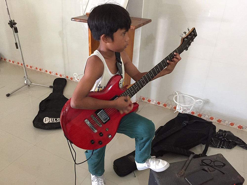 CJ Talan playing guitar - SIAC - Nov4 2019